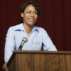 black-woman-speaking-at-a-podium